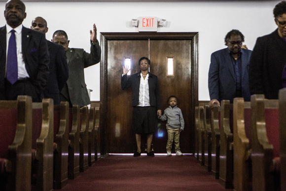 The congregation at Beulah Baptist raises their hands during worship. (Andrea Morales)