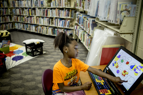 Janiya, 8, uses one of the computers in the kids' corner at the Cornelia Crenshaw Library.