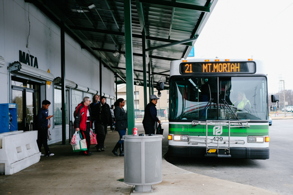 A group of passengers prepares to board a MATA bus at the American Way Transit Center on January 9, 2018. (Brandon Dahlberg)
