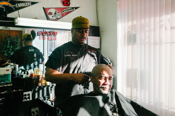 Staff Jones attends to a customer at his barbershop, Iconic Stylz. (Brandon Dahlberg)