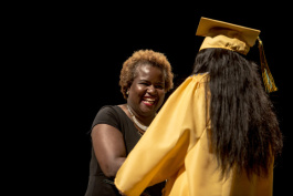 Principal Alisha Kiner shakes hands with a graduating senior of Booker T. Washington's 2017 class.