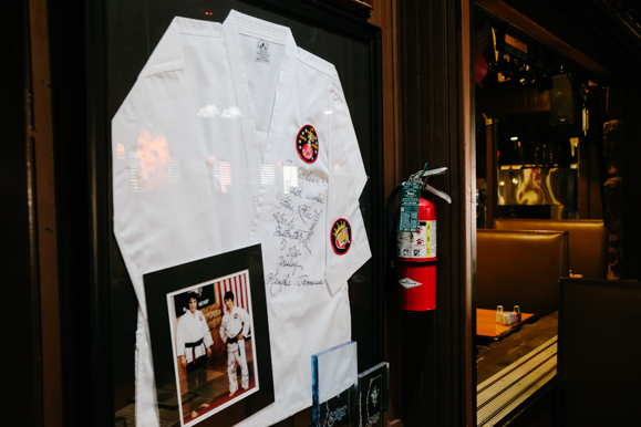 A signed gi and accompanying photograph of Elvis wearing it on display inside Marlowe's Ribs & Restaurant. (Brandon Dahlberg)