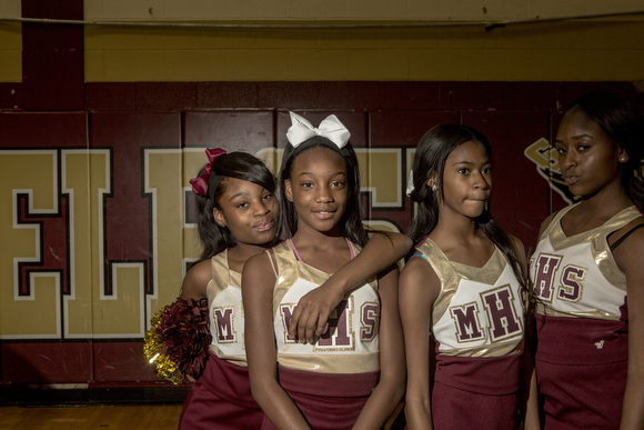 Cheerleaders take a moment between the action at the Melrose High School homecoming pep rally. (Andrea Morales)
