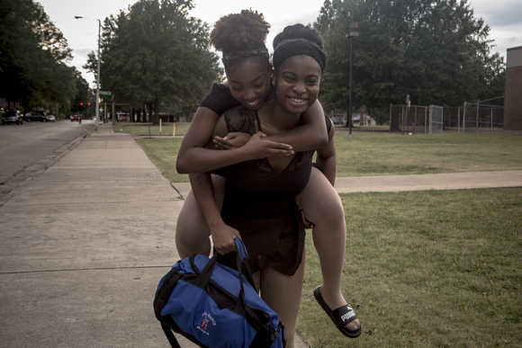 Asya Miles gets a lift to get around from Precious Price after hurting her ankle during ballet practice. (Andrea Morales)