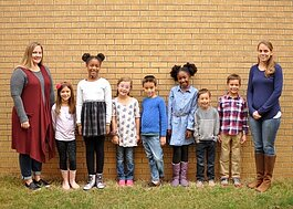 Sarah Gong (far right) and Kristin Thompson (far left) pose for a class picture with Sycamore School's second and third graders. They co-teach the combined grades. (Susan Kizzee)