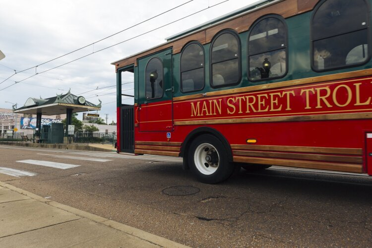 A modified MATA bus, designed to look like MATA's 100-year-old vintage electric trolley fleet, heads towards a trolley stop on Madison Avenue near Claybrook in Madison Heights. (Ziggy Mack)