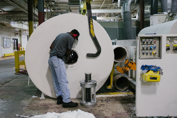 A KTG employee prepares a parent roll for the next stage of manufacturing. (Brandon Dahlberg)