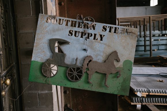 This sign, featuring a horse drawn carriage, was made by one of the workers at Southern Steel Supply. (Brandon Dahlberg)