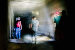 The group of urban explorers moves through the culvert shortly after entering the covered portion of the Gayoso Bayou. (Brandon Dahlberg)