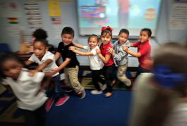 Yvonne Thomas' kindergarteners dance to a song about fruit  in one of Treadwell Elementary School's dual language classes on September 21, 2018. Treadwell's dual language program immerses kids in both Spanish and English for full fluency by fifth gra
