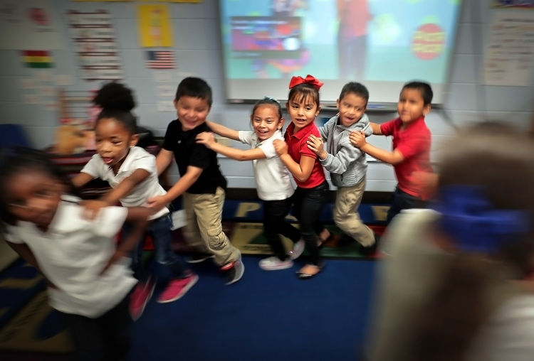 Yvonne Thomas' kindergarteners dance to a song about fruit  in one of Treadwell Elementary School's dual language classes on September 21, 2018. (Jim Weber/Daily Memphian)