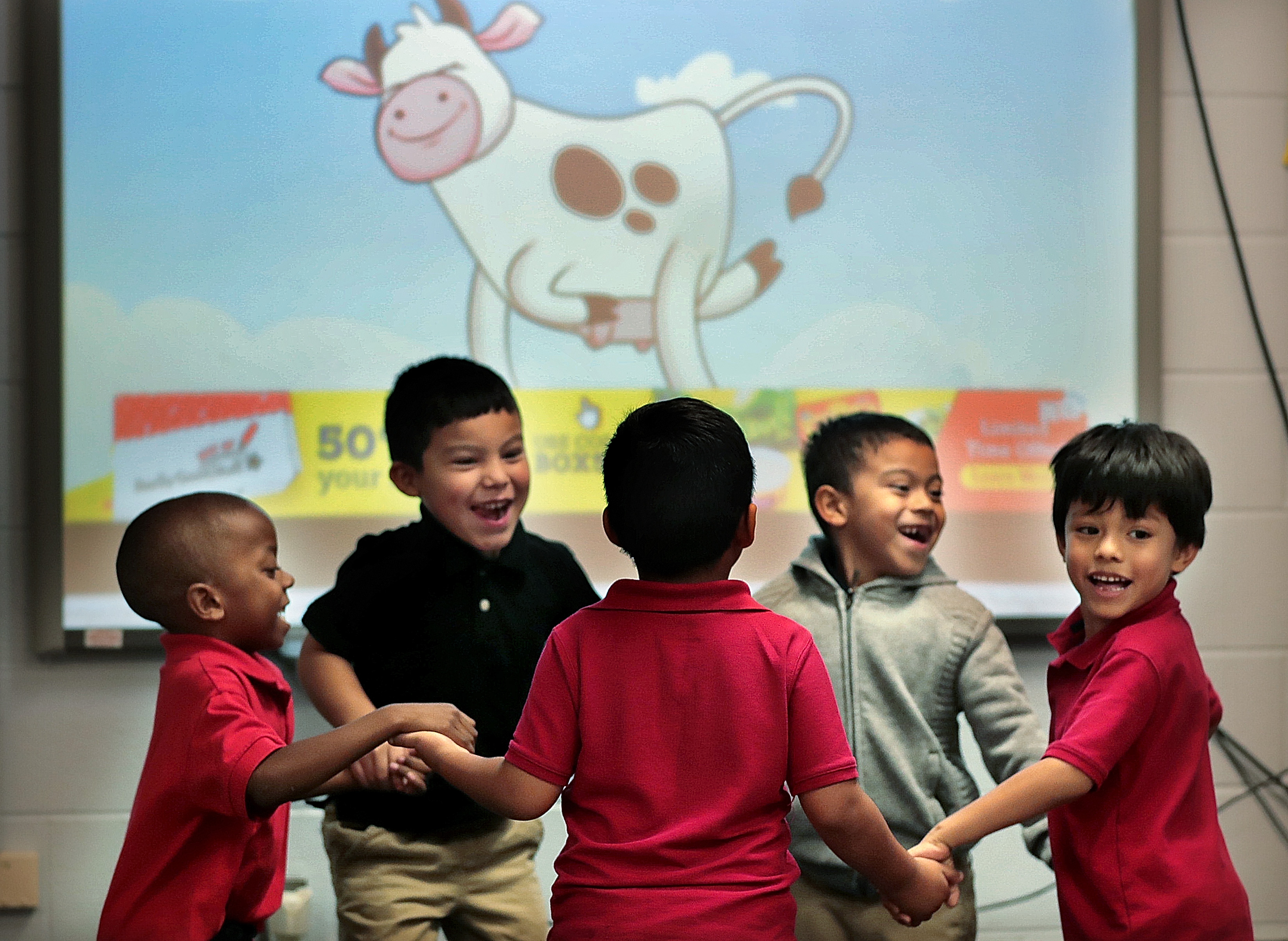 Yvonne Thomas' kindergarteners dance to a song about cows in one of Treadwell Elementary School's dual language classes on September 21, 2018. (Jim Weber/Daily Memphian)