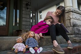 Victoria Kintner-Duffy sits on her porch in Central Gardens with her daughter. Her daughter is 6 1/2 years old and was diagnosed with autism at 4. Kintner-Duffy said it's been a years-long process to get a diagnosed and proper support. (Ziggy Mack)