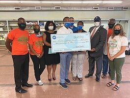 Nonprofit JUICE Orange Mound recently received their largest single donation. ADT Securities donated $10,000 towards its community improvement efforts. (Submitted)