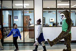 "Students at Memphis Scholars Caldwell-Guthrie play  with their school mascot ""Jiggy."""