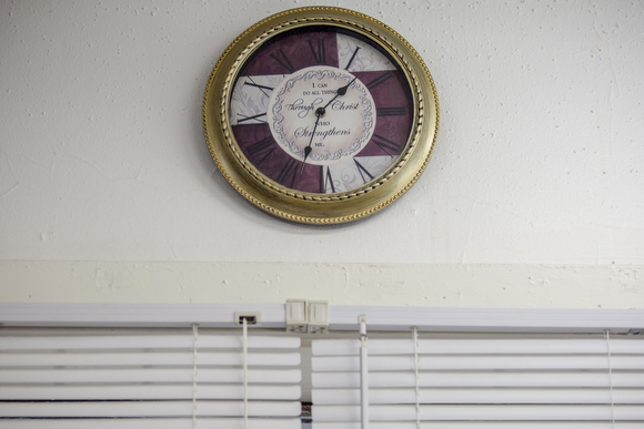 "A clock with the message ""I can do all things through Christ, who strengthens me,"" hangs on the wall at the Handy Spot, a barber shop on Vollentine Avenue in Klondike."