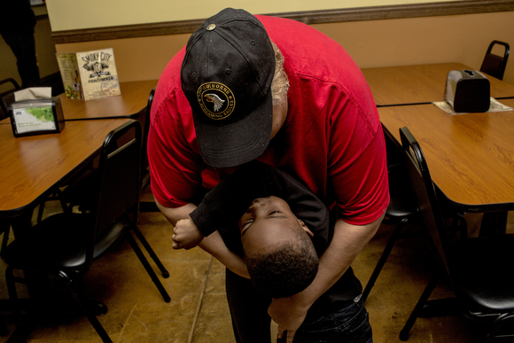 Frankie Walter hugs her grandson Kentrel while taking a break from working at Smoky City Bar-B-Que.