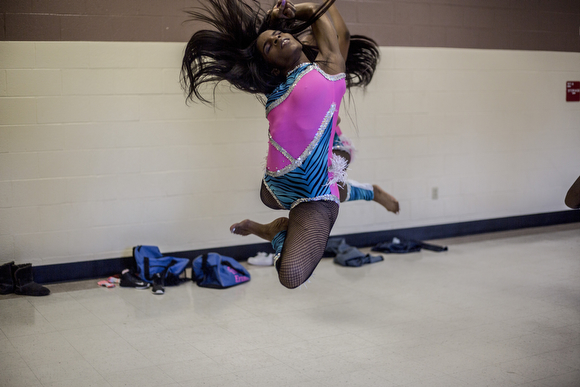 Ebony Parker, 18, leaps during a dress rehearsal at the Dave Wells Community Center in Smokey City.