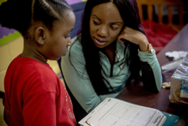 Jasmine Craig helps Alexis Dorse, 7, with her math homework at the John Dustin Buckman Boys & Girls Club's learning center.