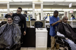 Jerome Pope (L) and Robert Coates (R) cut hair at The Barber School on Jackson Avenue in Klondike.