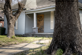 A boarded up home on Bellevue Boulevard in Klondike carries a message to deter break-ins.