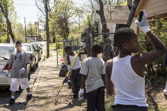 Folks from the community organization Crowning Our Youth, Inc. an anti-violence and youth oriented group, worked to clean up vacant lots along Randle Street in Klondike.