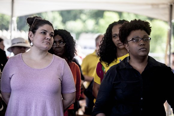 Laura Wilfong Miller (left) whose great grandmother was aunt to Antoinette Rappel and Michele Lisa Whitney (right) whose great uncle was Ell Persons had front row seats at the ceremony and joined folks on a hike to the lynching site.