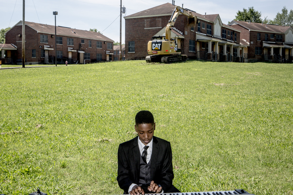 McKenly Carodine, 12, plays the piano during the City of Memphis ceremony announcing the demolition of Foote Homes.