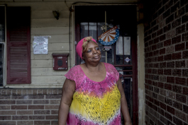 Betty Isom stands in front of her home she purchased in ZIP 38126.