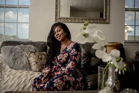 Ashley Gladney, owner of Mobile Mommy, stands for a portrait in her South Memphis home.