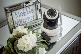 The larger camera serves as a nanny cam that parents can access via an app on their phone. The smaller camera is a body worn camera that babysitters can wear on request of the clients.