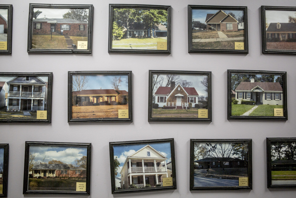 A detail of the wall at the RISE Memphis office that has the photographs of the houses that have been purchased by folks with the help of the foundation's financial literacy programs.