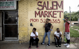Folks hang out outside of Salem's Market on Mississippi Avenue. The store has been open for decades in the neighborhood and has seen a significant slowing of business since Foote Homes closed and demolition started.