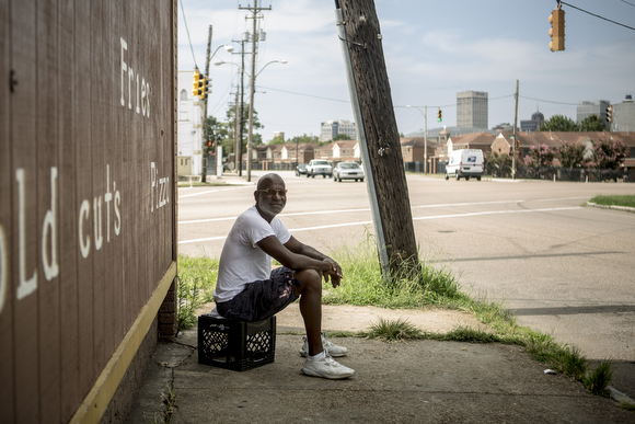 Demetrius Triplett hangs out outside of the Friendly Food Mart on the corner of Danny Thomas and Mississippi Avenue. It closed earlier in the summer after business slowed down following the shutting down and demolition of Foote Homes.