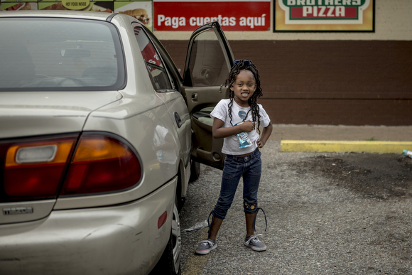 Aja pauses for a portrait while at A-1 Speedy Corner while on a trip with her mom.