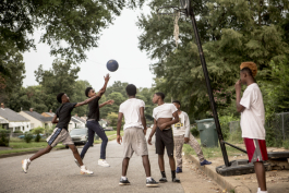 A game of basketball along Radford Road in Orange Mound.