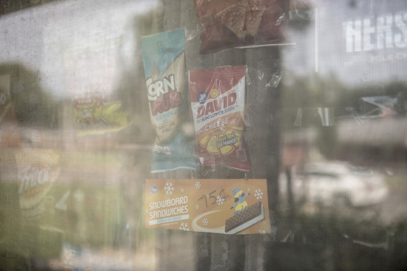 Deidra Tuggle, the Candy Lady of Orange Mound, displays her offerings on the window of her home.