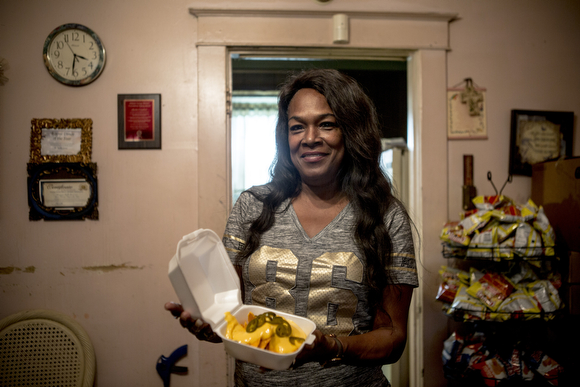 Deidra Tuggle, the Candy Lady of Orange Mound, serves up a nacho plate in her kitchen for her after school customers.