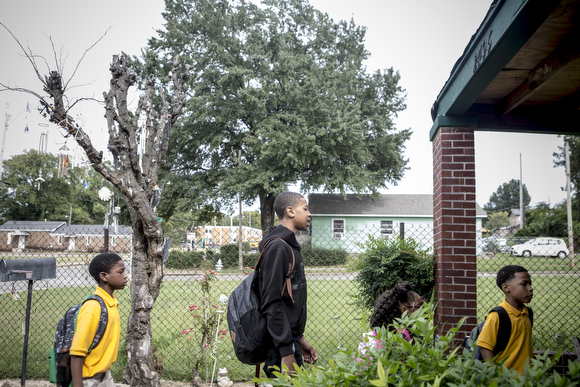 Kids start lining up at the home of Deidra Tuggle, the Candy Lady of Orange Mound.