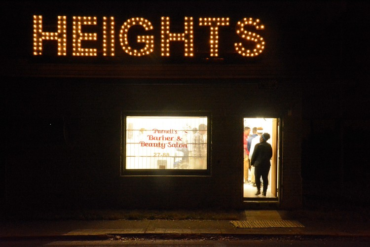 The vacant barber shop at 769 National Street was topped with a sign made from repurposed Christmas lights and the boards that once shuttered the windows. (Markus Mueller)