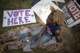 Alandria Ivory, a campaign worker for Memphis for All, takes a break during an early voting event at Glenview Community Center. (Andrea Morales)