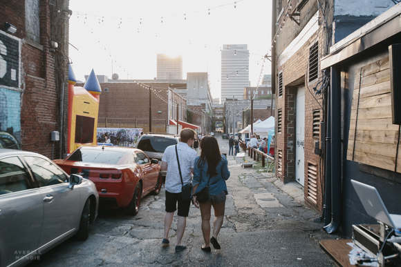 A couple walks down Floyd Alley towards the main stage are the The Edge alley party.