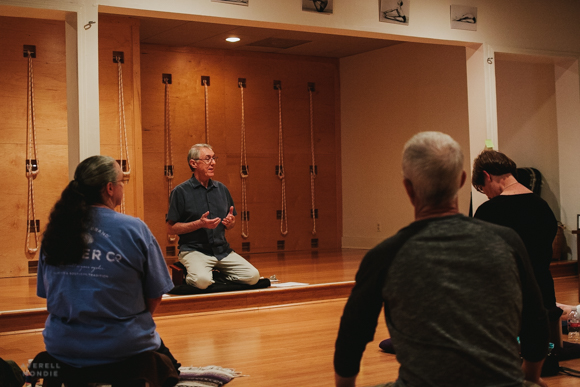 Dan Lamontagne (center) leads a meditation class at the Evergreen Yoga Center.