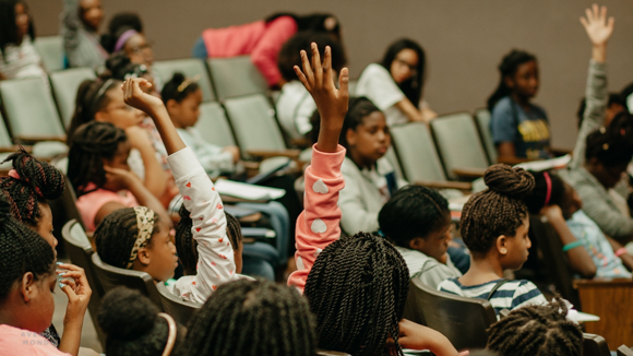 A watchful audience during the Envision Lead Grow summer camp.