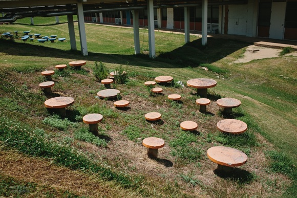 A seating arrangement located in the green space of the elementary school, which closed in 2012.