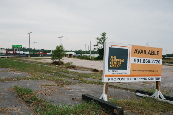 A real estate sign denotes the availability of the Frayser property sits advertising the proposed use of a shopping center.