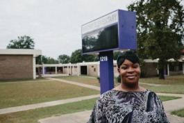Stephanie Love stands in front at Whitney Elementary in Frayser, which residents say is negatively affected by a nearby landfill.