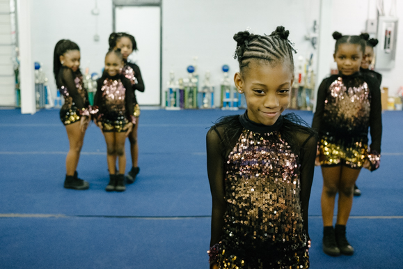 The Memphis Area Youth Association tinys group, the youngest group at ages four through six, pose before beginning one of their dances. (Brandon Dahlberg)