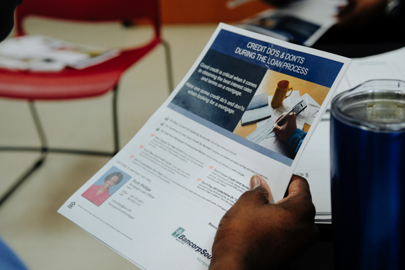 A Job Corps student reviews a credit strategy brochure during a class being led by BancorpSouth. (Brandon Dahlberg)