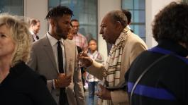 Multimedia artist Lawrence Matthews of The Collective talks with Dr. David Acey, professor of African-American rhetoric and creator of Africa in April at Black Resistance Opening Reception hosted by The Brooks programmed by The CLTV. (Ashley Bend)